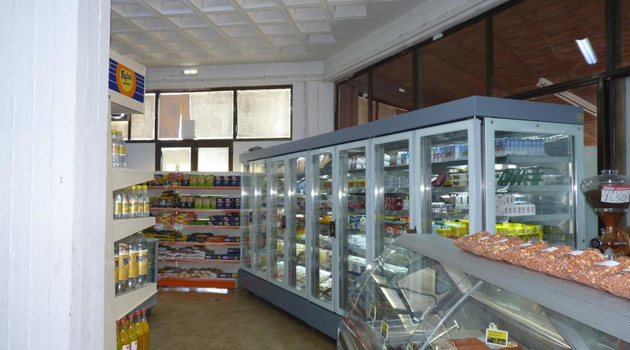 Supermarket with residential apartment for sale.