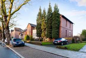 Large property with semi-detached houses and parking spaces