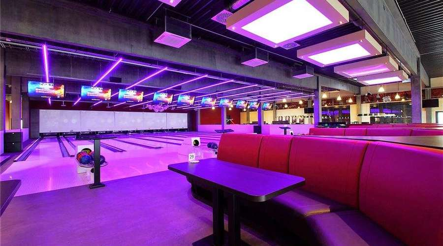 Modern bowling center with event area and catering