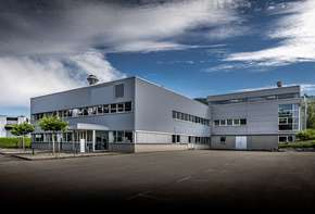Company building complex with office and social rooms, storage and production hall