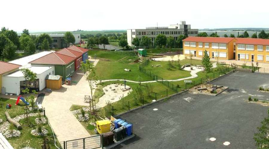 School building with children's house and sports hall